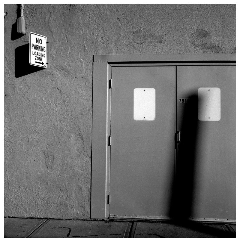 back door, loading zone sign