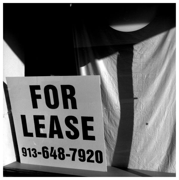 for lease sign in a store window - photo