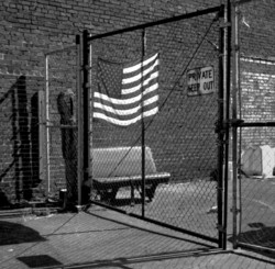 flag and chain link fence - grant edwards photo