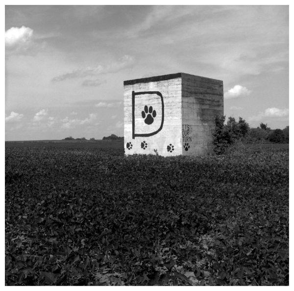 drexel bobcats sign in a farm field, b&w photo