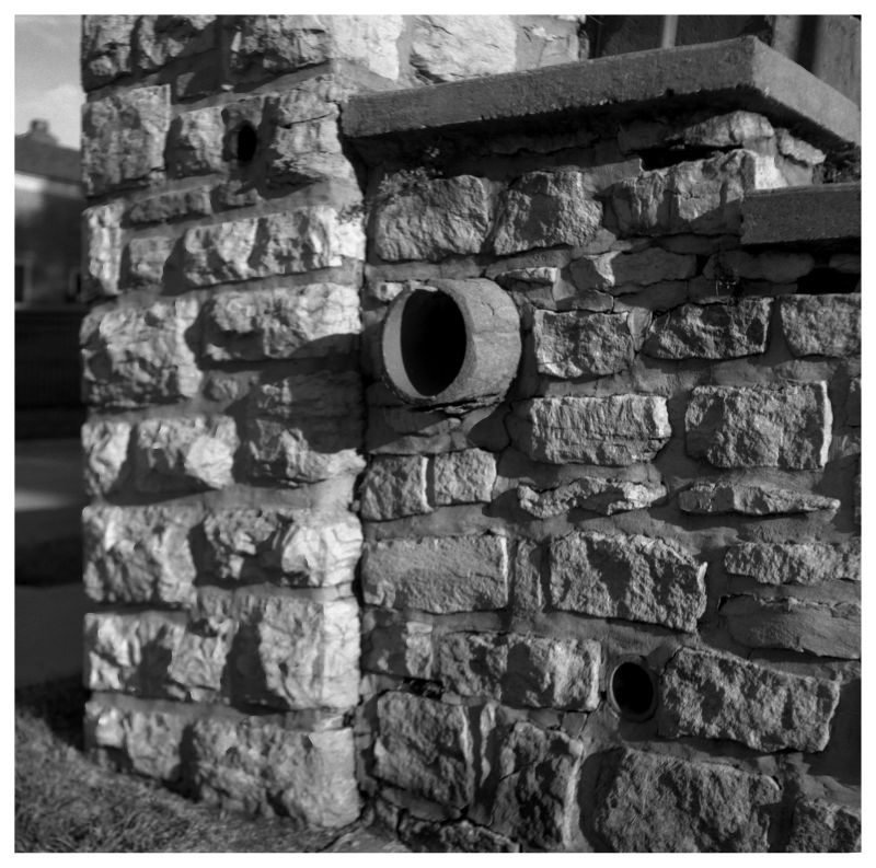 drain in stone wall - grant edwards photography
