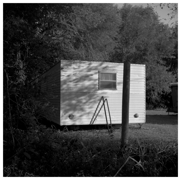 trailer in woods - grant edwards photography
