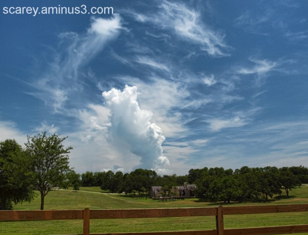 Storm clouds rise over a farm in rural Alabama