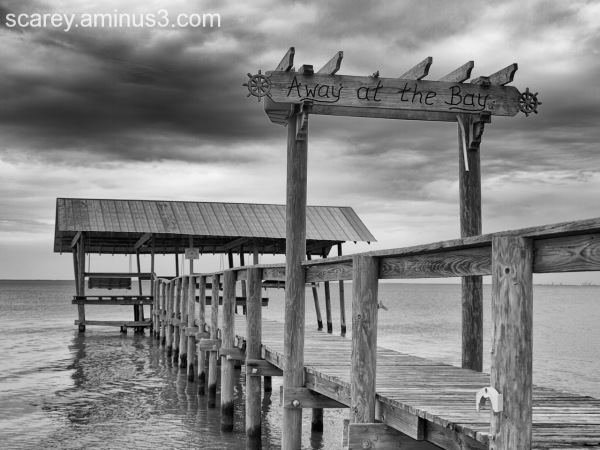 Stormy weather and a pier on Mobile Bay, Alabama