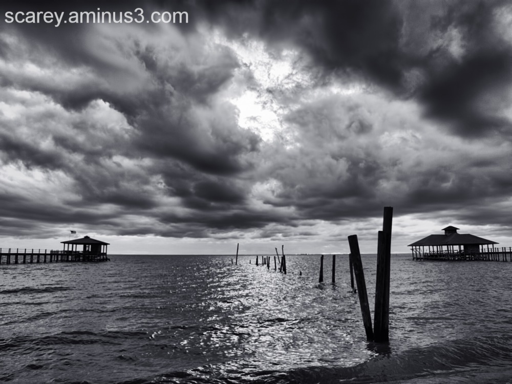 Black and white image of clouds over Mobile Bay