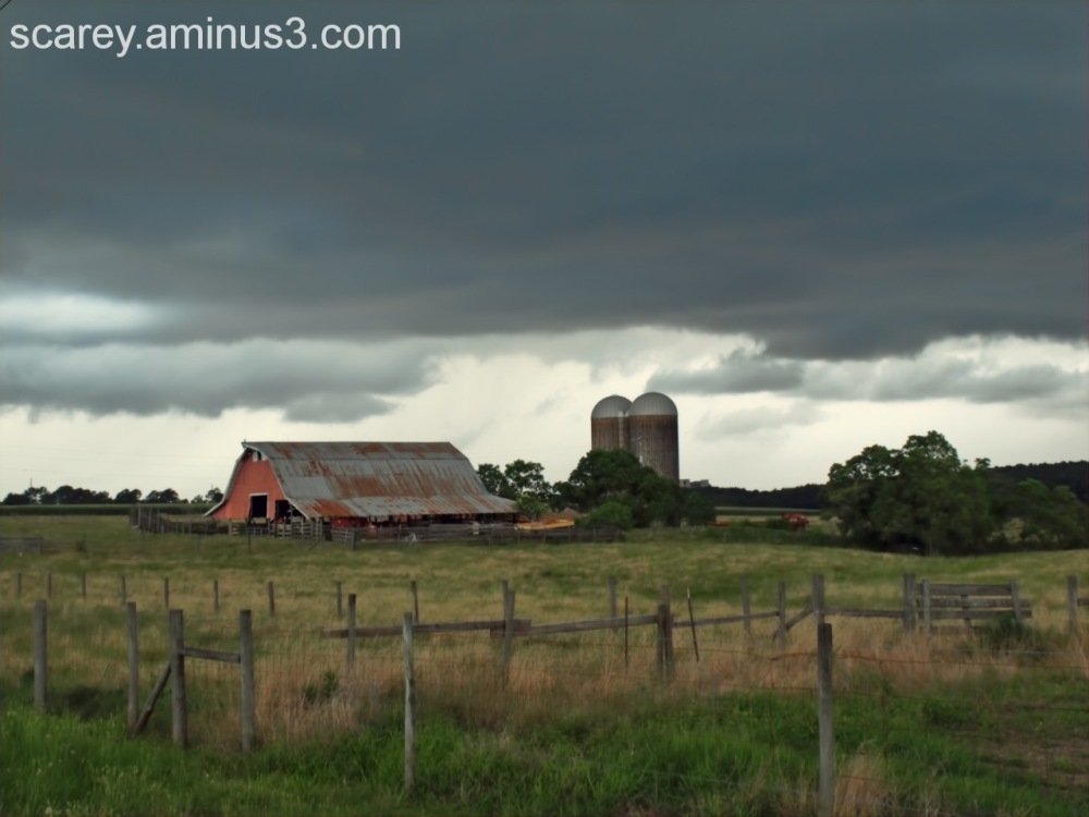 storm forms backdrop for rural farm