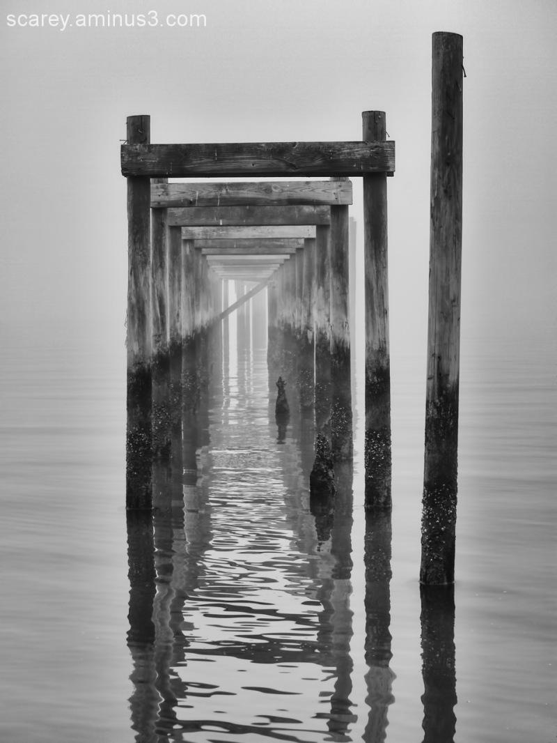 Old pier along Mobile Bay, Alabama in fog