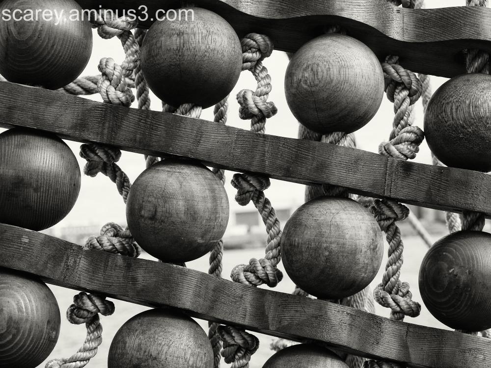 Wood balls and rope on El Galeon sailing ship.
