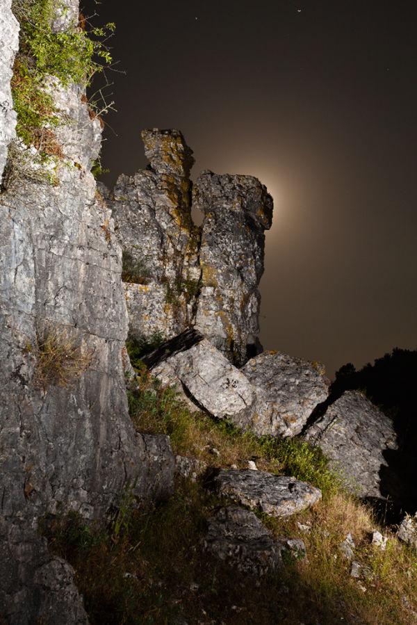 Full moon behind the rocks