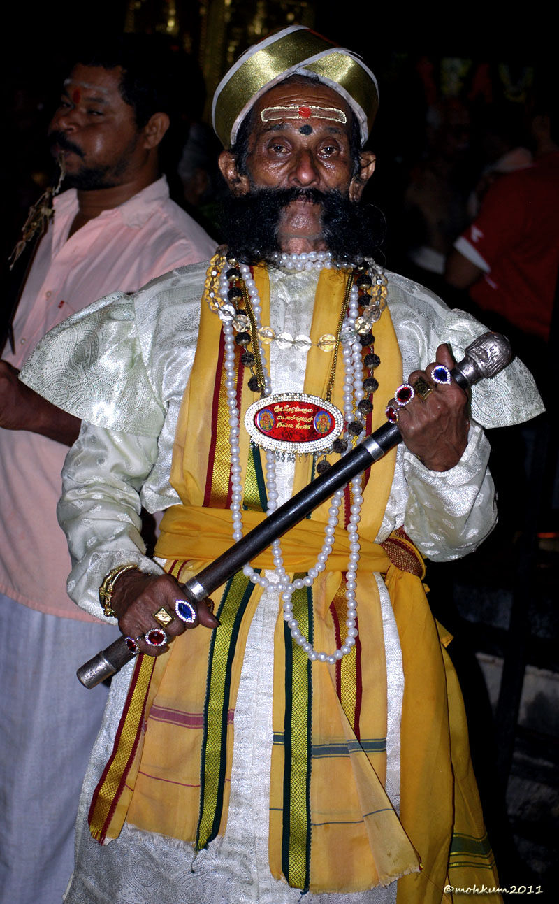 His colourful costume and silver crown!