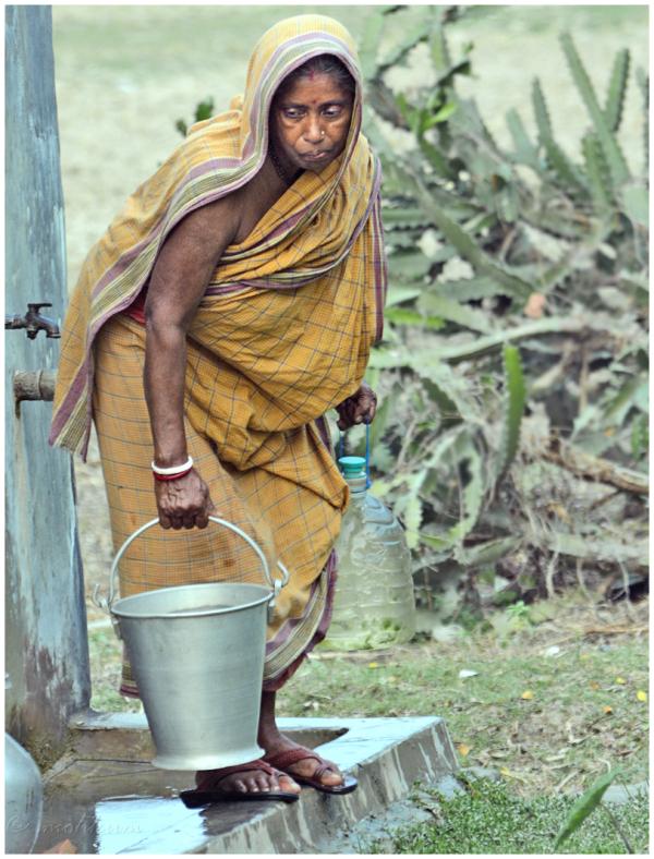 woman water pot street village sunderbans kolkata