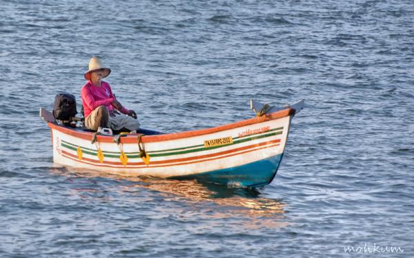 fisherman boat sea