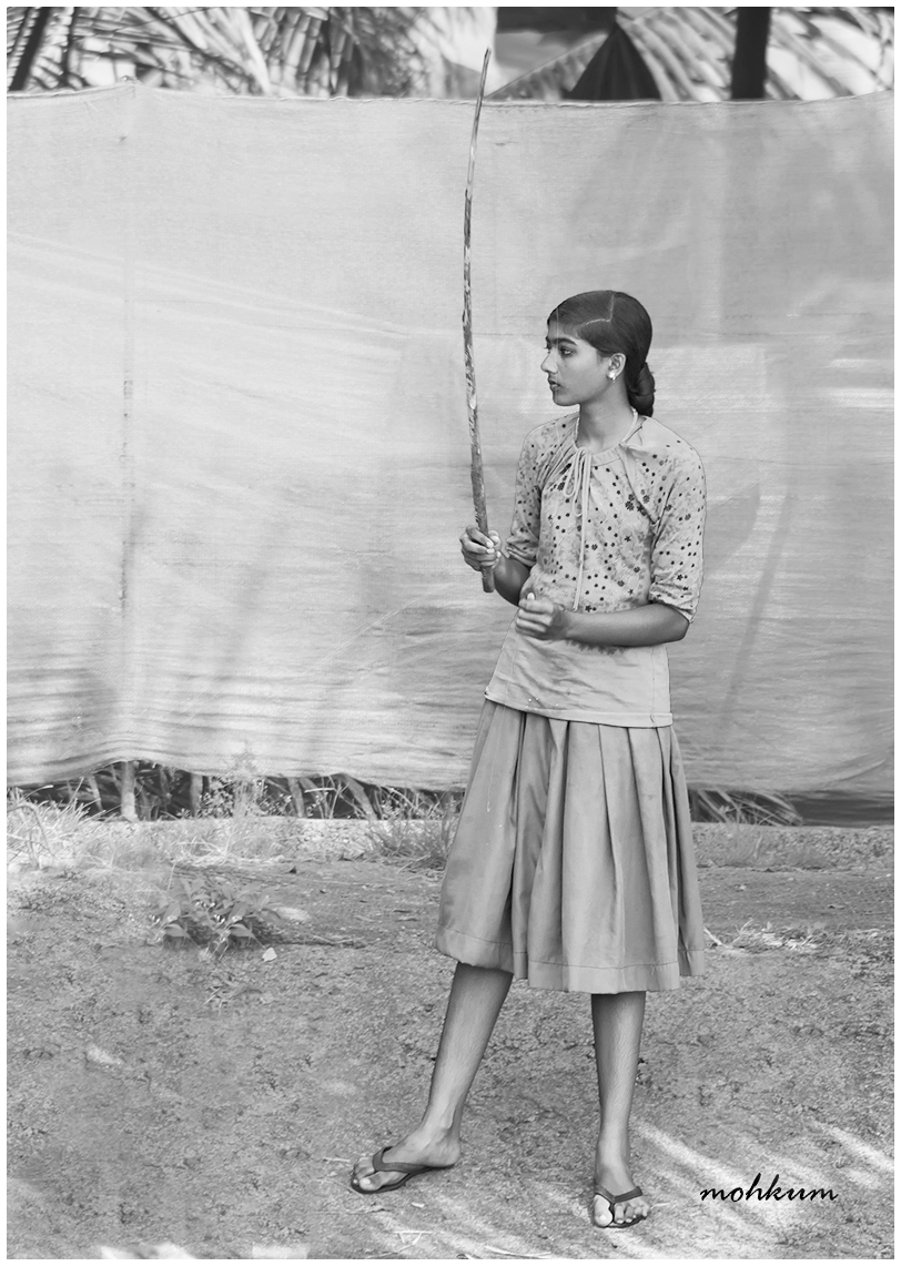 girl fishingrod backwaters kumarakom