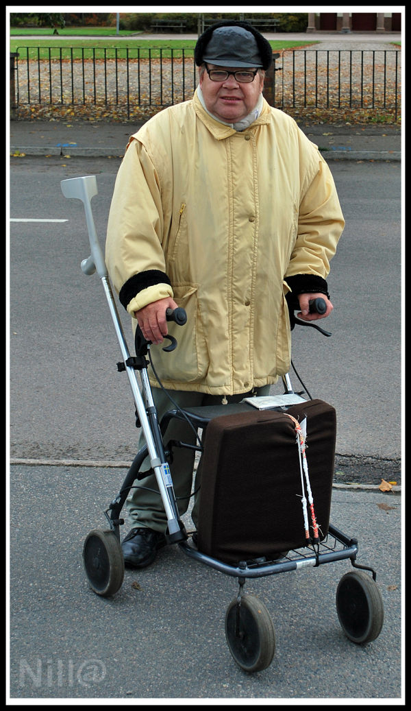man with walking frame