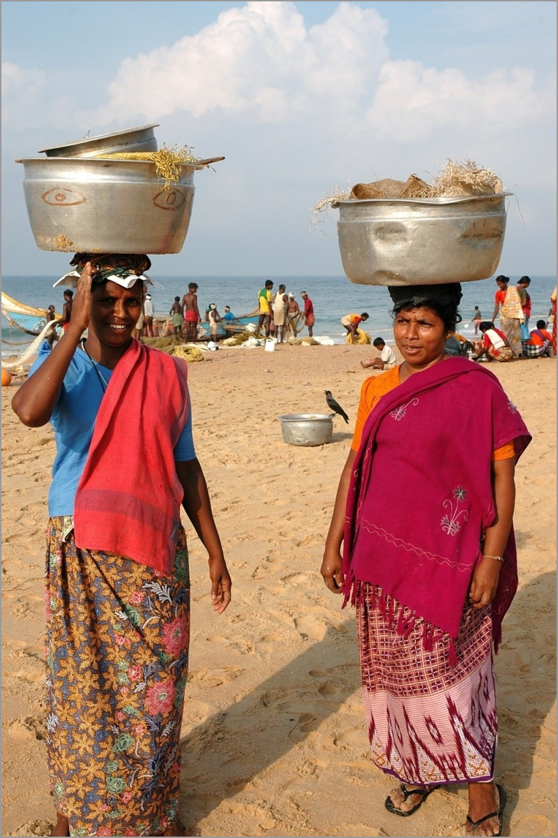 Fishermans wives on Chowara Beach, Kerala, India.