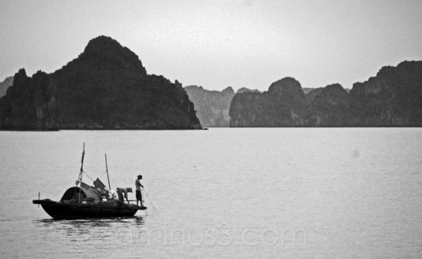 Fisherman pulling in day's catch from Halong Bay