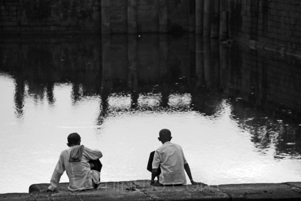 Cambodian Men relaxing by Angkor Wat lake