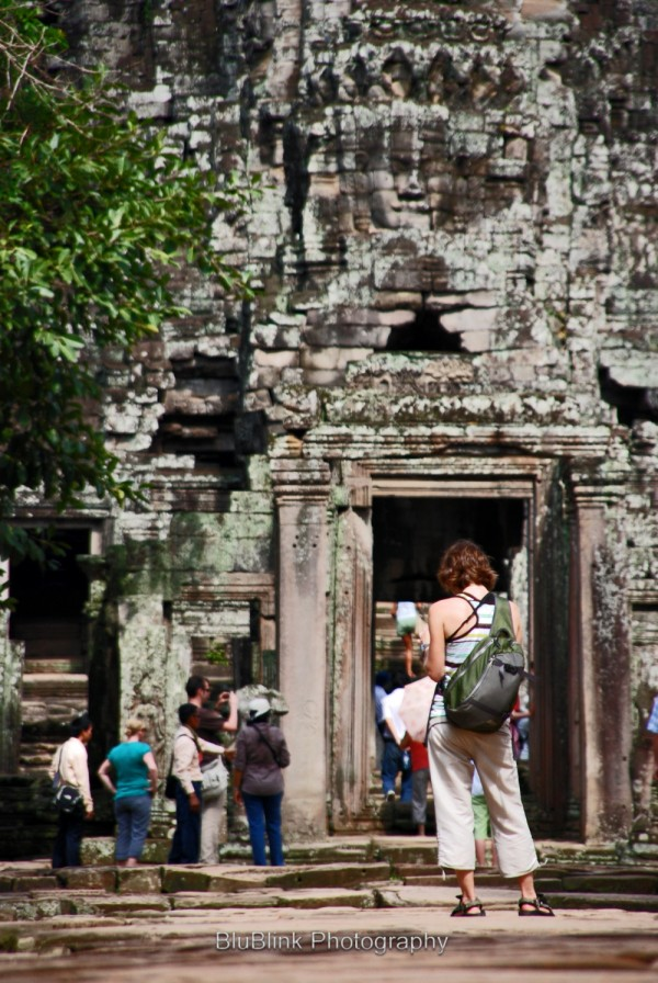 Tourist at entrance to Angkor Thom temple