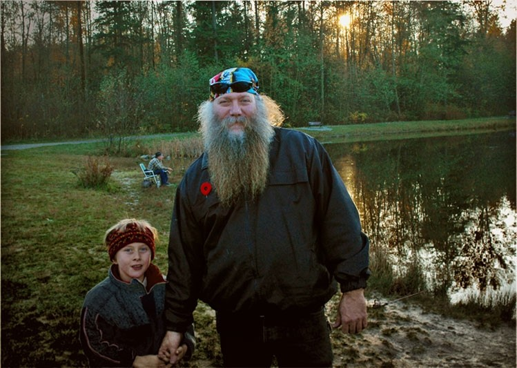 bearded man with son at lakeside