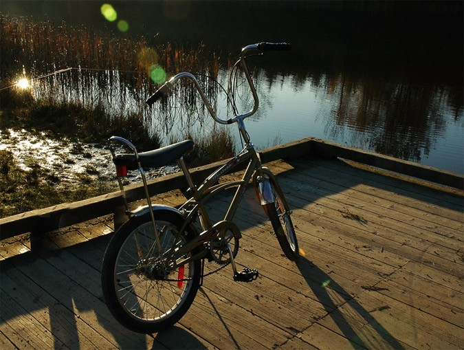 Bike left on dock by lake