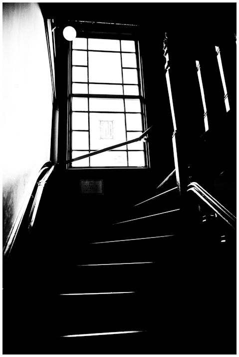 a monochrome image of an old staircase.