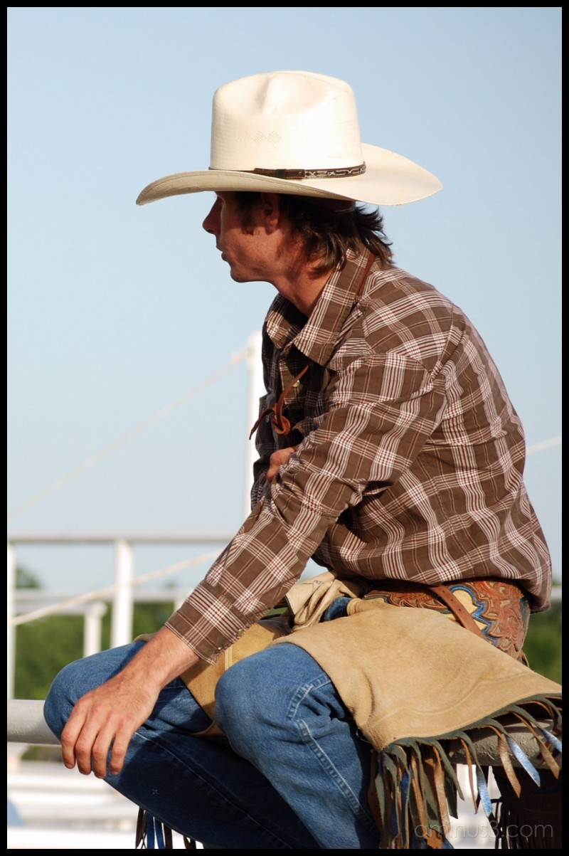 Cowboy thinking before riding a bull at a rodeo