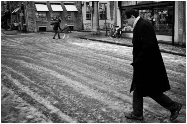 crossing the street in the snow
