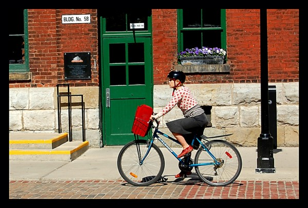 Woman cycling in distillery district