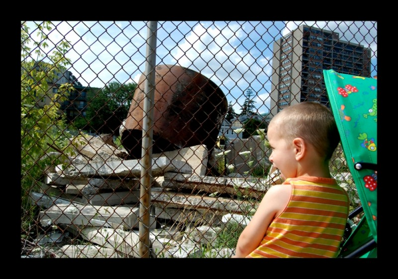 Child looking at brownfield