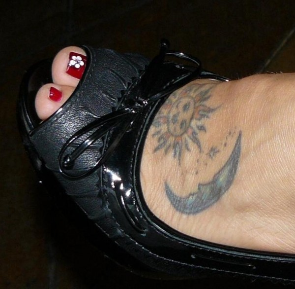 Lovely fem foot with tattoo at Amy & Raf's wedding