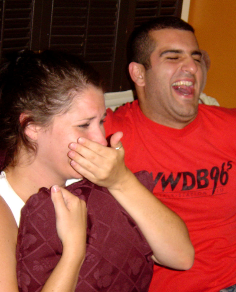 Couple reacts hysterically to TV with laughter