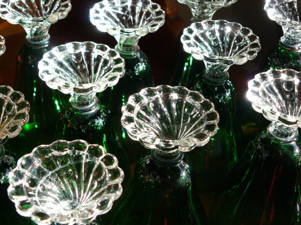 stems of green glass goblets waiting on hutch