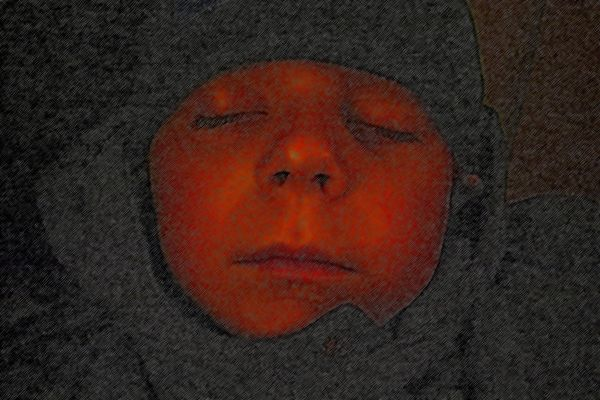 Chris sleeping in hooded coat with photoshop