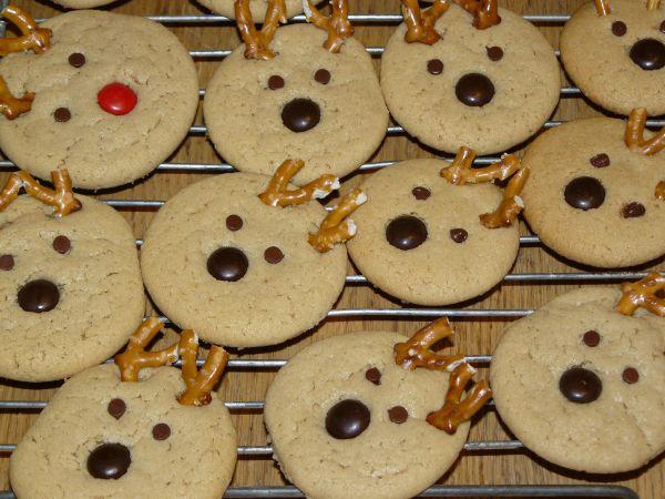 Christmas cookies of reindeers cooling on a rack.
