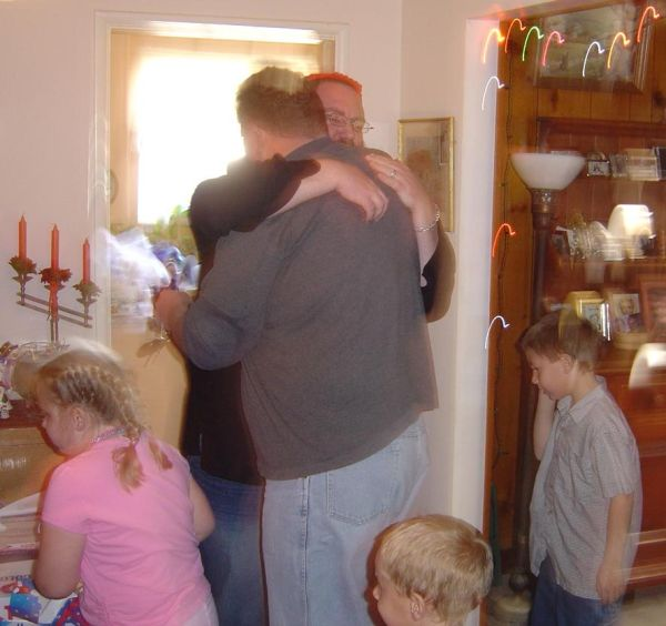 Adult Brothers Hug in Thanks at Christmastime