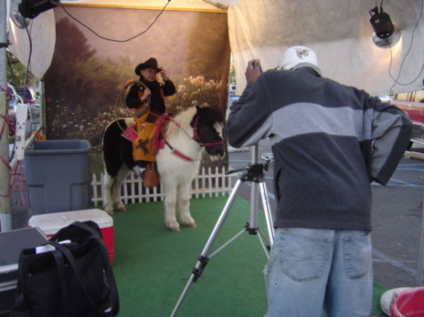 boy becomes cowboy for portrait on a pony