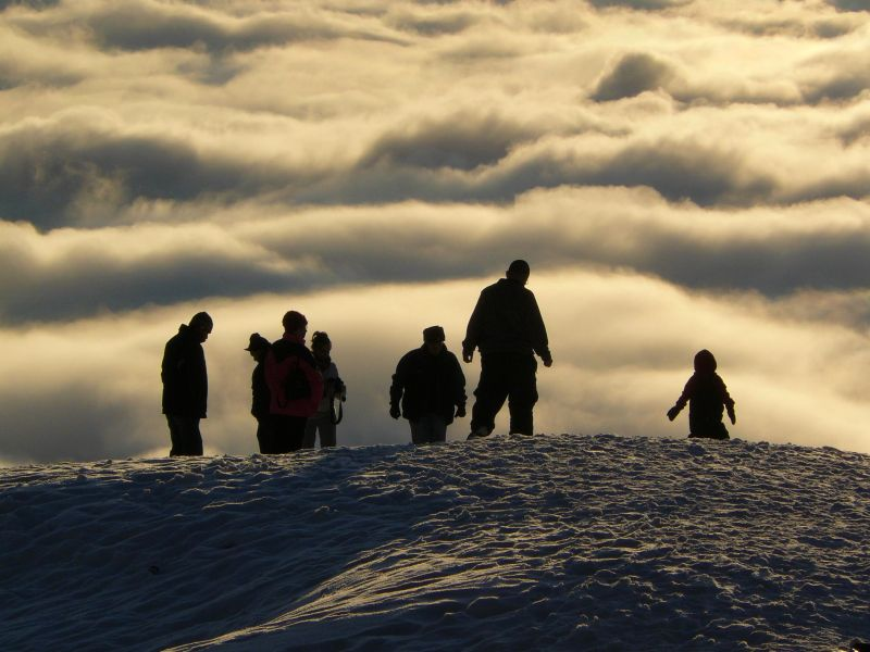 Snowy observation of the view above the cloudbank