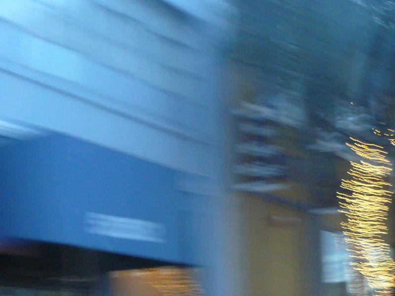 Trees alight on blue San Francisco Street