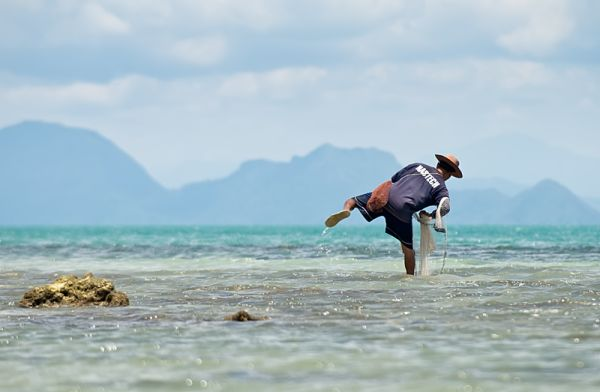 fisherman balancing on one leg