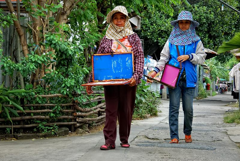 Women selling lottery tickets in Bangkok