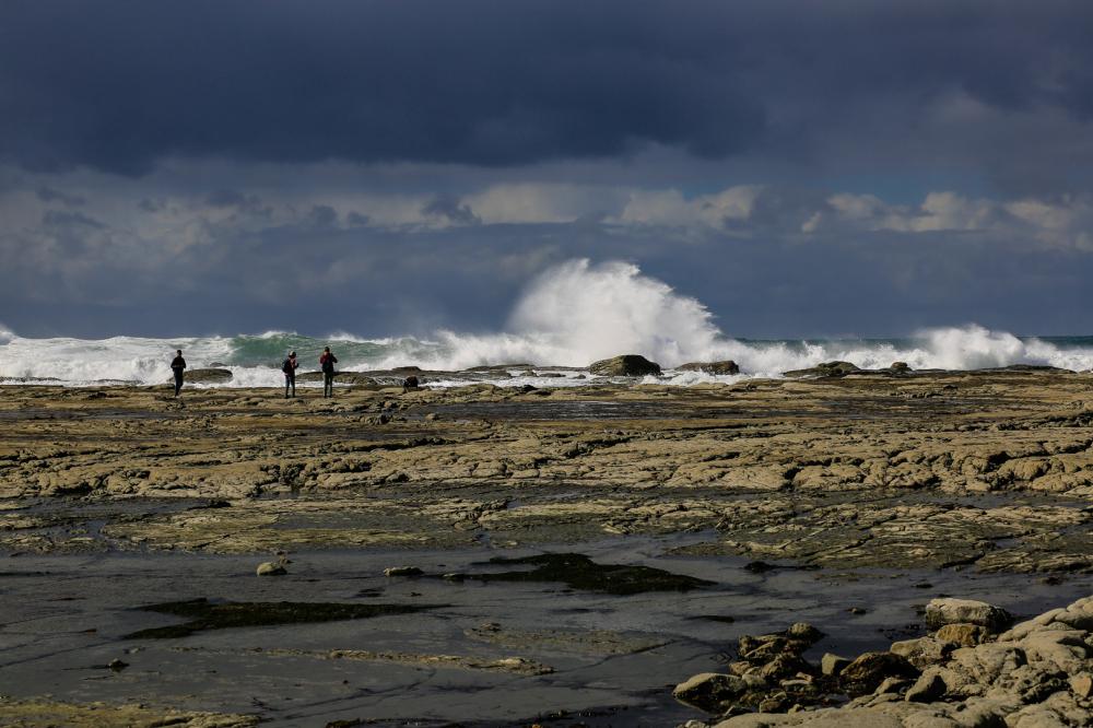 dwarfed by the waves