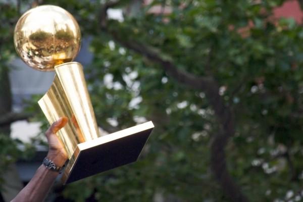 Kevin Garnett Displaying NBA Championship Trophy