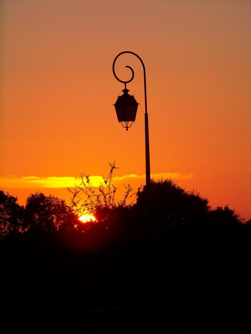 lamp post contrasting against orange sundown