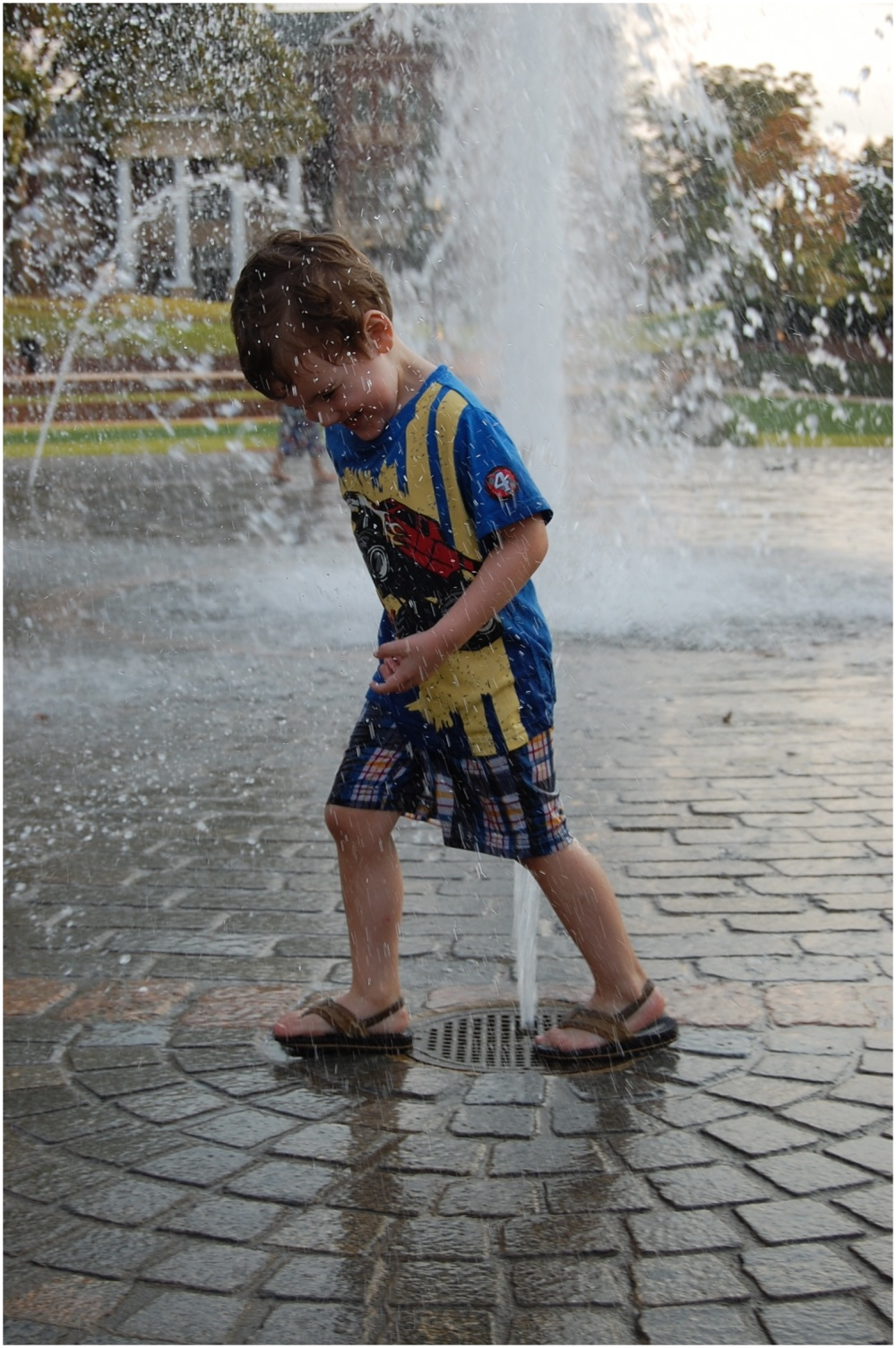 Boy running through a fountain