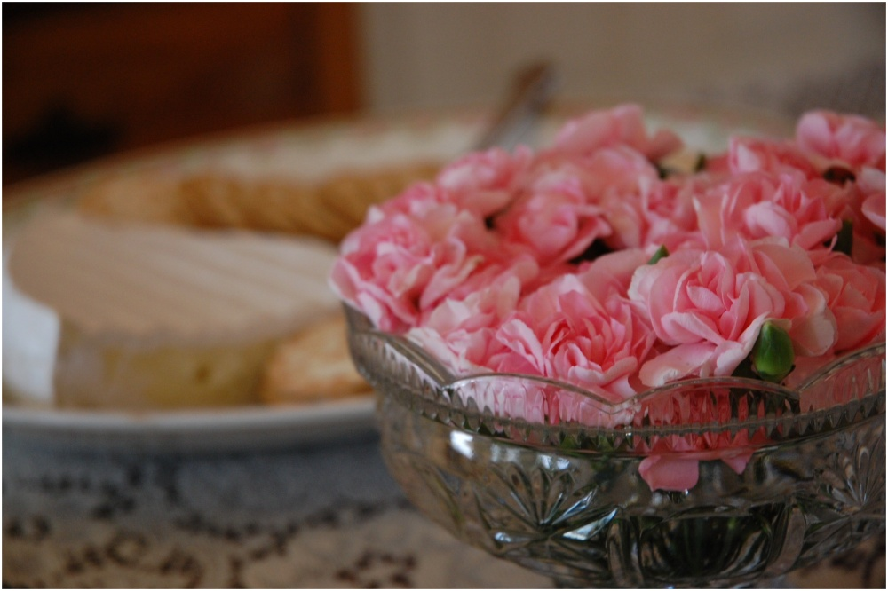 Pink flowers in glass bowl center piece.