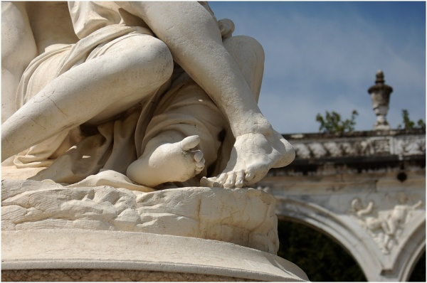 Feet of a statue in the gardens of Versailles