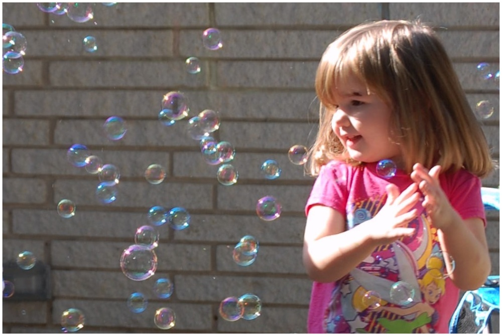 K playing with bubbles.