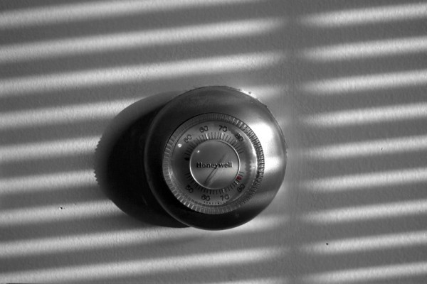 thermostat with a shadow cast across it