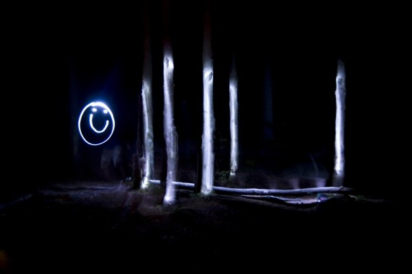 painting with light at night drawing on trees