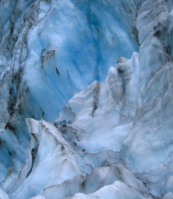 Standing on Franz Joseph Glacier in New Zealand